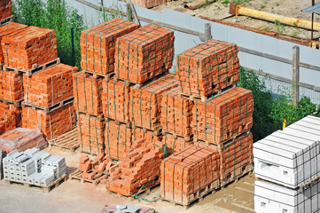 Stack of red clay brick on construction site