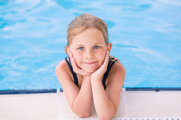 Cute little girl in swimming pool