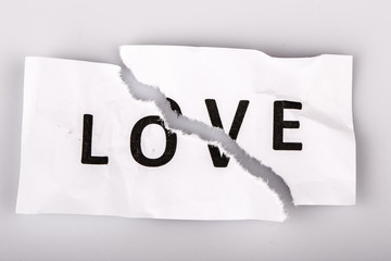 """Love"" word written on torn paper"