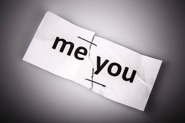 """ME YOU"" words written on torn and stapled paper"