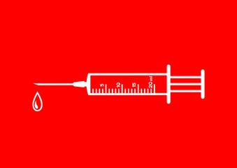 Medical syringe on red background