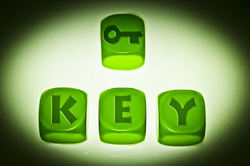 Key symbol with word KEY on cubes
