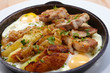 fried meat with potatoes and egg