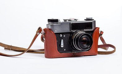 Old film photo camera in leather case