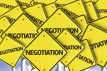 Negotiation written on multiple road sign