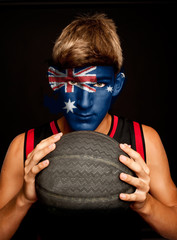 basketball player with australian flag painted on his face