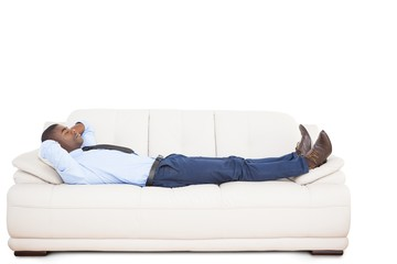 Businessman lying asleep on couch