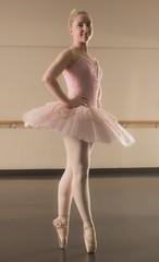 Beautiful ballerina standing en pointe