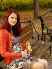 beautiful pregnant woman walking in autumn park