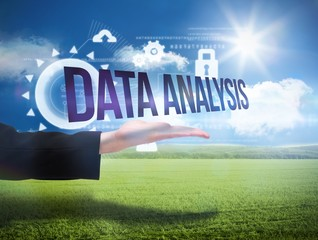 Businesswomans hand presenting the words data analysis