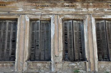 window shutters chipped wall