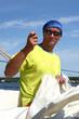 Man repairing sail