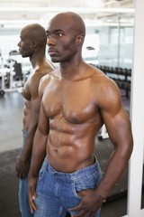 Muscular man with reflection looking away