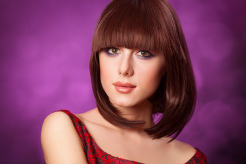 Brunette girl on vilet background.