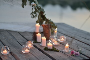 on a wooden bridge on the river at dusk romantic arrangement of