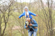 Grandfather Carrying Grandson On His Shoulders.