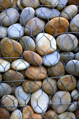 Background of pebbles behind a fence
