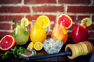 four fresh lemonades with fruits and ingredients