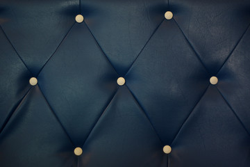 white bottoned on blue leather pattern background