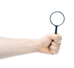 Caucasian male hand holding magnifying glass