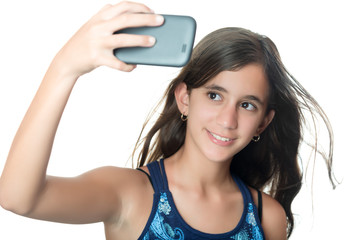 Young hispanic girl taking herself a portrait