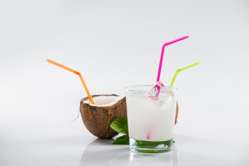 Coconut cocktail on white background
