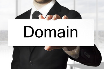 businessman holding sign domain