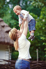 Mother in park playing with her laughing son