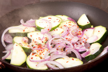 copped courgette, red onion and dried chili