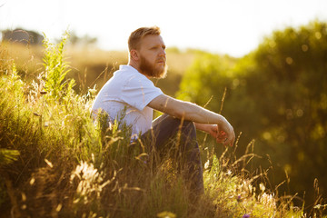 Man sitting on the grass in the evening