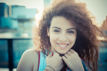 young beautiful long curly hair hipster woman