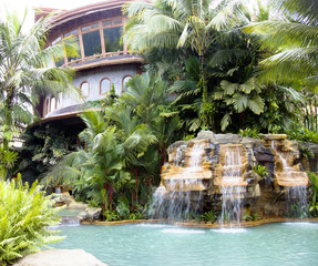 Swimming pool with a waterfall and hot thermal water, Costa Rica