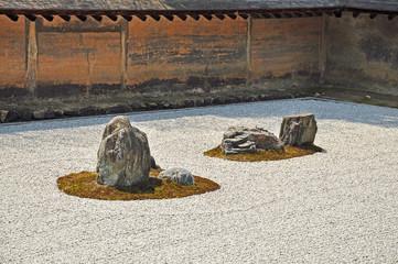 Zen rock garden at Ryoanji temple in Kyoto, Japan.