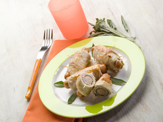 stuffed roll with wurstel and sage
