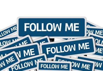 Follow Me written on multiple blue road sign
