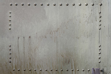 Old metal surface of riveted metal from aircraft.