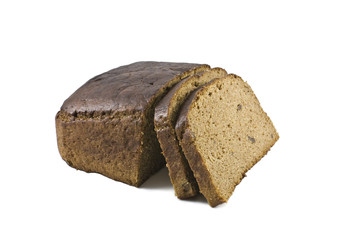 loaf of brown bread and hunches of bread isolated against white