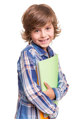 Boy holding school books