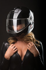 Sexy young woman with motor bike helmet