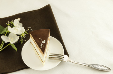 Piece of cake, decorated with jasmine flower