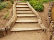 Old wooden stairs in traditional garden, tourist footpath