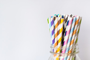 Colorful Paper Straws in Mason Jar on White Background