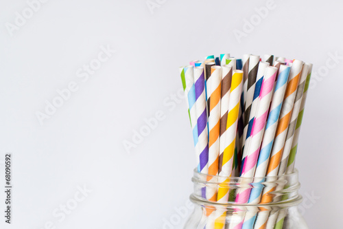 Colorful Paper Straws in Mason Jar on White Background - 68090592