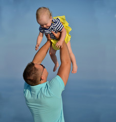 Happy young man father holding new born infant child baby girl t