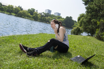 young woman laughting on the phone