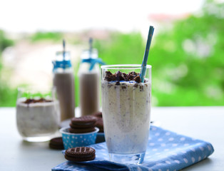Milk cocktails in glasses and chocolate cookies
