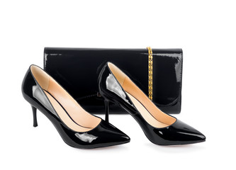Beautiful black shoes with clutches on white isolated background