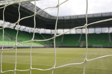 Soccer goal and net in green stadium