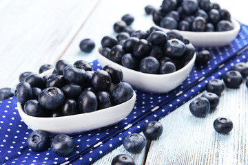 Delicious blueberries on table close-up