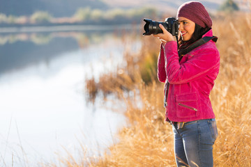 photographer take photos outdoors in autumn